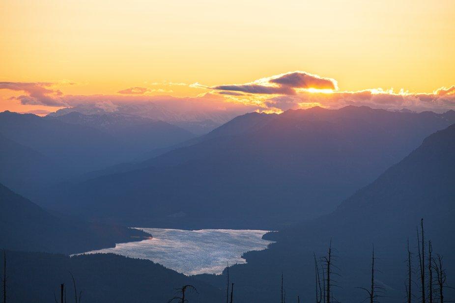 Facing Pacific Northwest, I saw this irresistible beauty of sunset engulfing the cascading mounta...