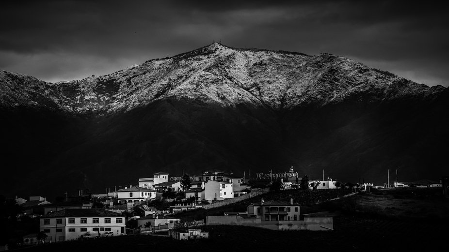 Snow capped mountain over Manilva , Andalusia , Spain