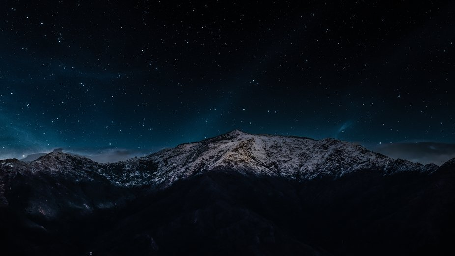 Starry night over snow capped mountain