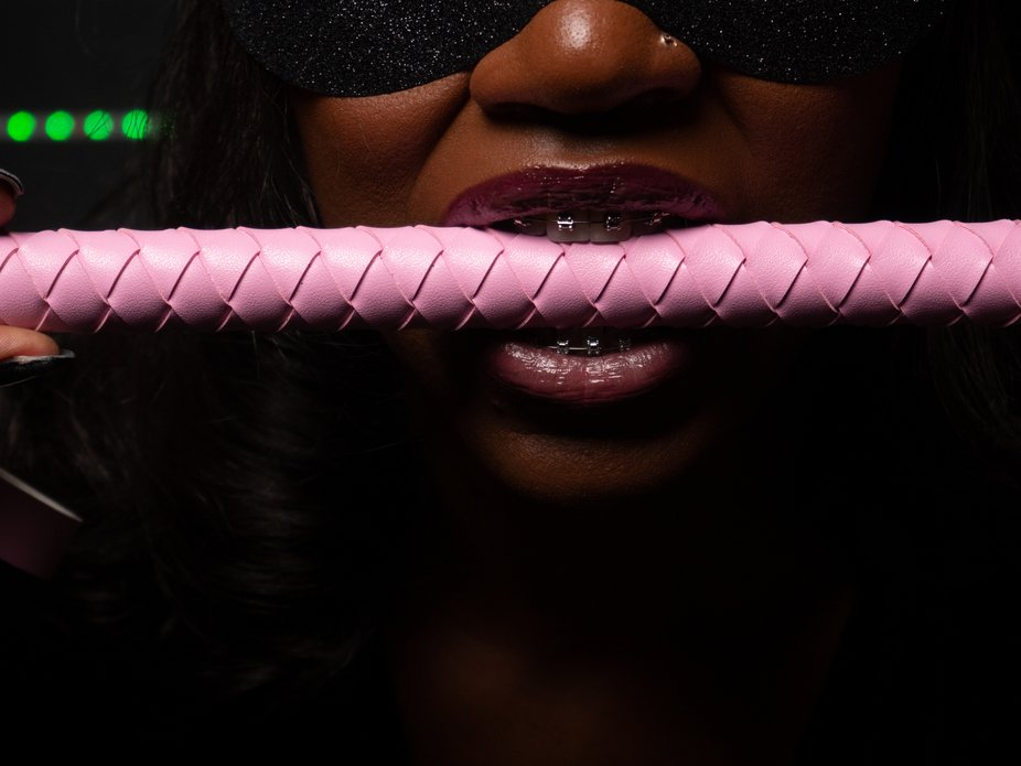Lady Lorna biting down on her riding crop