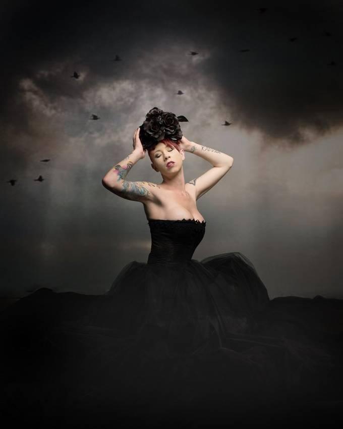 Tasha calls to the storm as her Raven minions circle