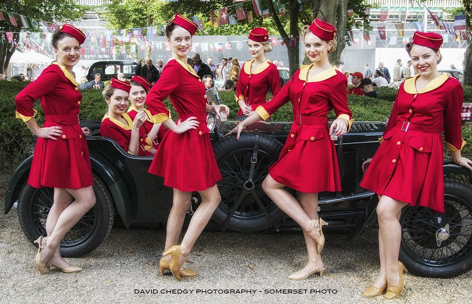 The famous Glam Cab Girls at the Goodwood Revival, who can resist booking a ride.