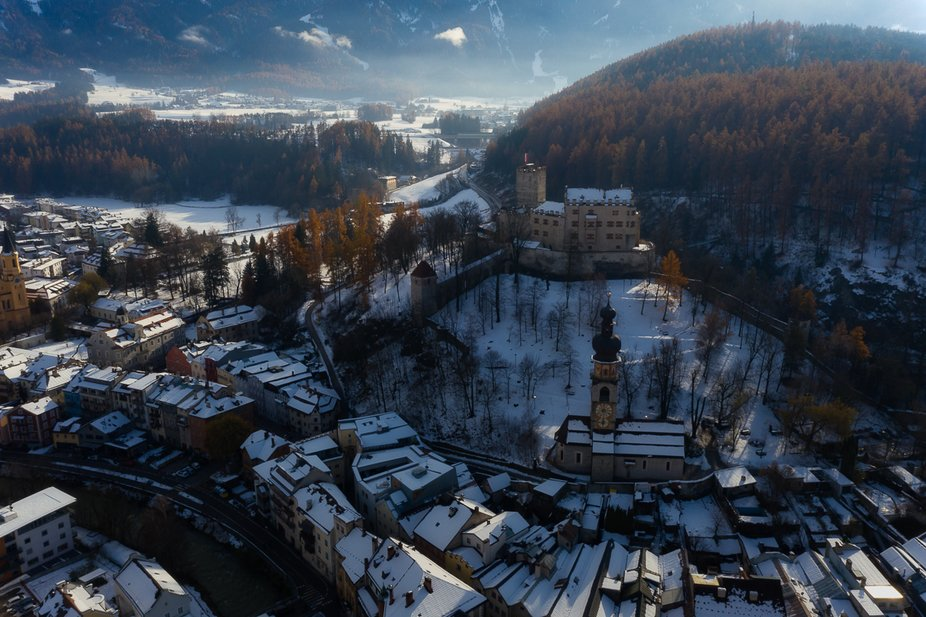Photo in the beautiful city of Brunico, Italy in a winter sunrise.