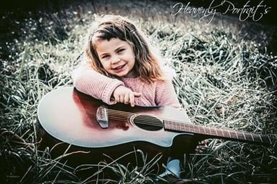 Little Girl's and Daddy's Guitar