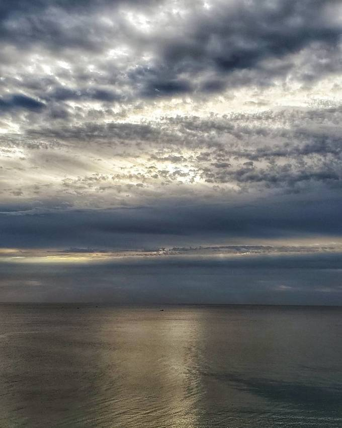 Took this shot early over the Atlantic Ocean from my winter retreat balcony in Pompano Beach Florida.  I just loved the layering of color of the sky, the brilliant shimmer on the ocean.