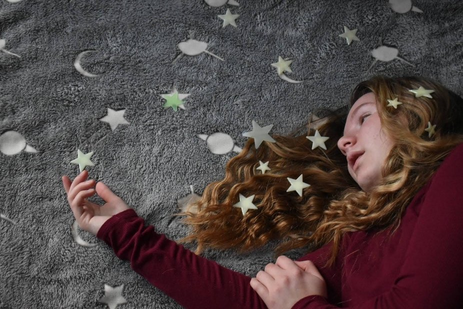 A girl with stars around her