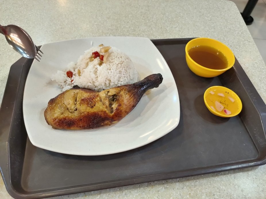 Filipino style of chicken rice with tamarind soup and vinegar