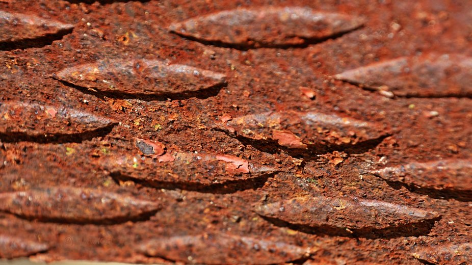 Interesting pattern and texture on this metal plate - part of some type of drilling equipment.  M...