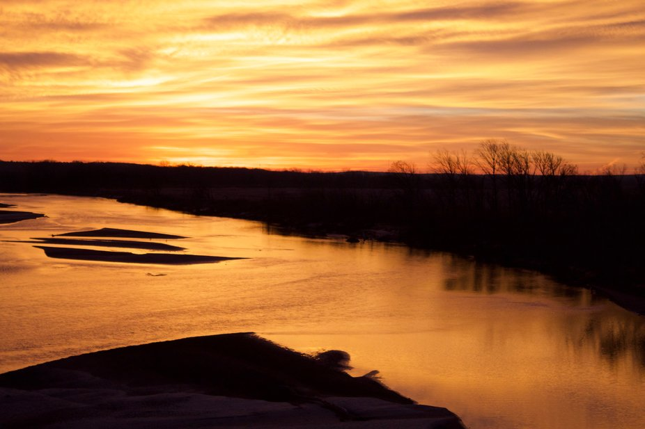 A sunrise in southeastern :Oklahoma on the South Canadian River near Holdenville Oklahoma.