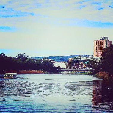 The majestic River Torrens with the background of the Adelaide CBD looking straight ahead