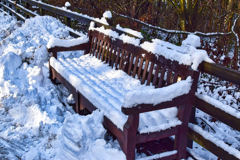 Park bench in the snow at Beamish Museum UK.