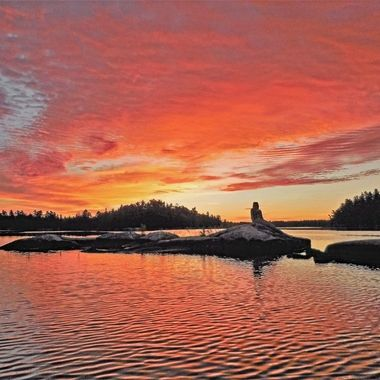Sunrise over the legendary Mermaid of Rainy Lake