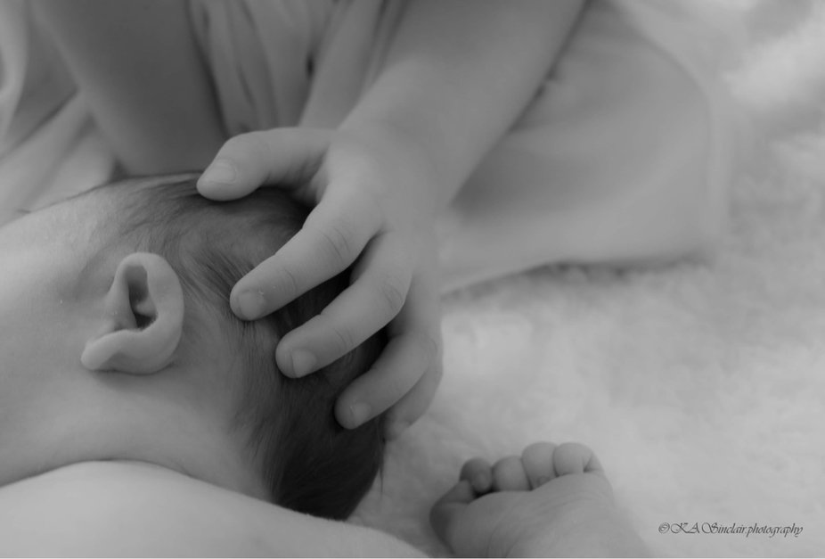 An older sister gentle  touch on the newborn  baby was too sweet too not capture. We were rearran...