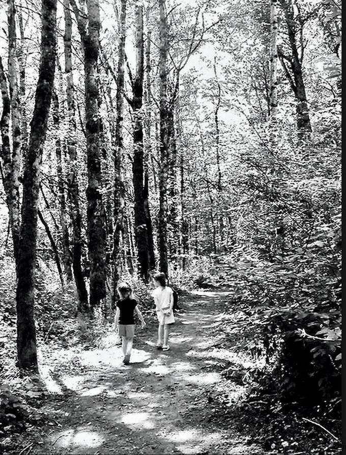 These are 2 of my granddaughters.  We would walk through the cool of the woods on hot summer days.  Our rottie, Champ, is lurking somewhere trying to watch both the squirrels and our girls!