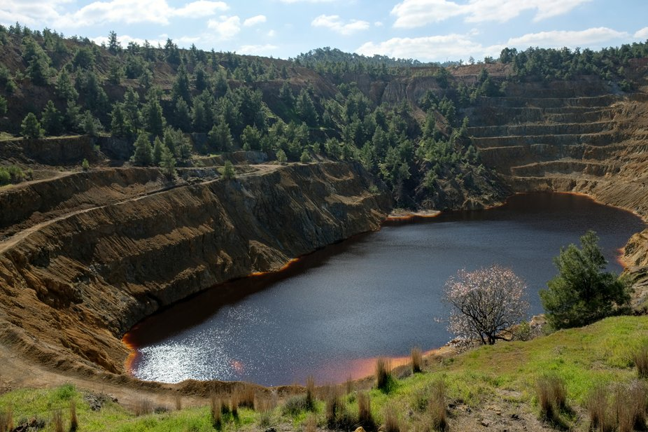 An abandoned copper quarry in Mitsero has become a red (bloody) lake. The water is coloured by th...