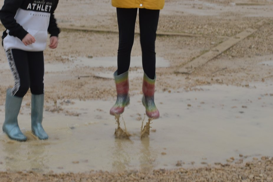 Just jumping around.  Look like the water is pushing you out of puddle