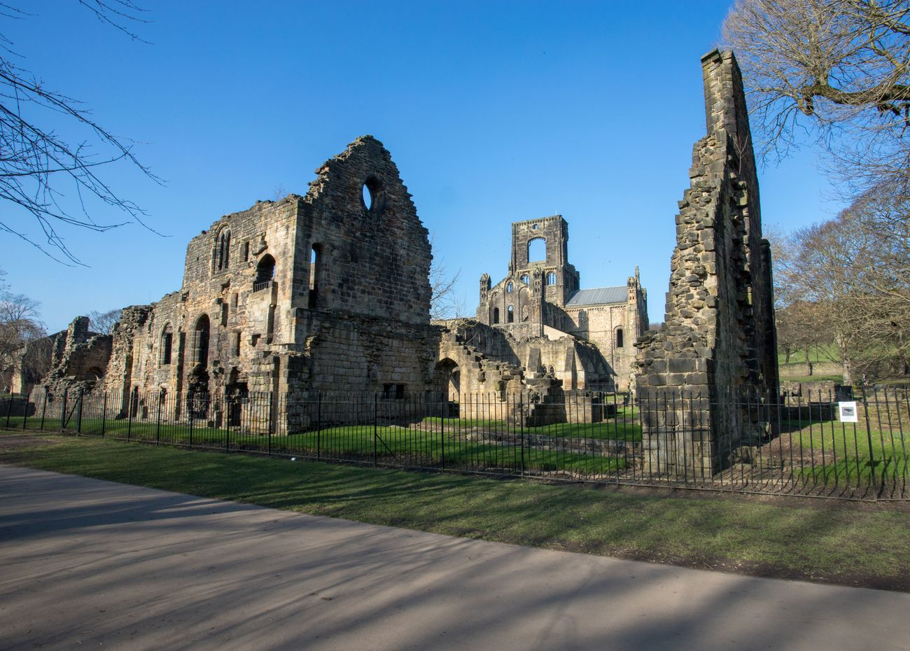 Kirkstall Abbey is a ruined Cistercian monastery in Kirkstall, north-west of Leeds city centre in West Yorkshire, England. It is set in a public park on the north bank of the River Aire. It was founded c. 1152. It was disestablished during the Dissolution of the Monasteries under Henry VIII.