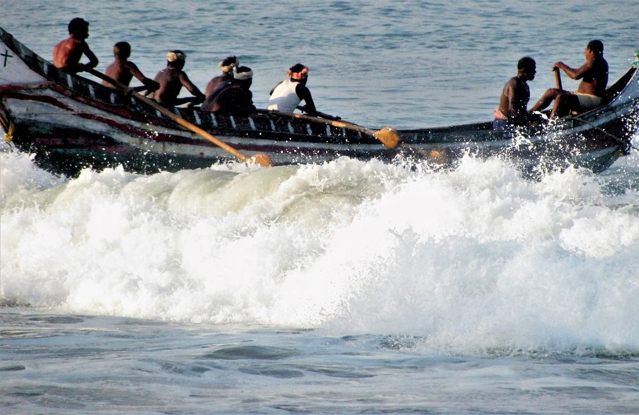 Fishingboat arriving to Kovalam beach in the morning