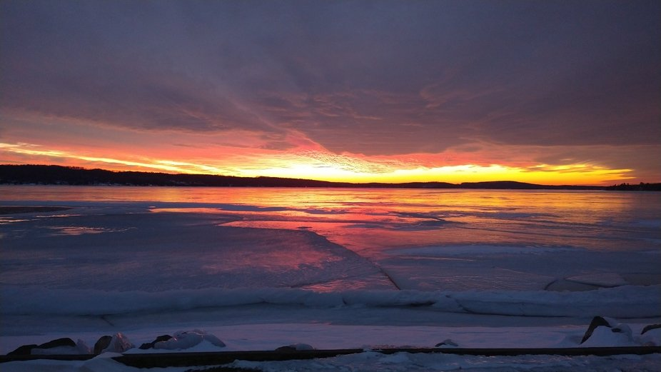 Sunset over the icy lake