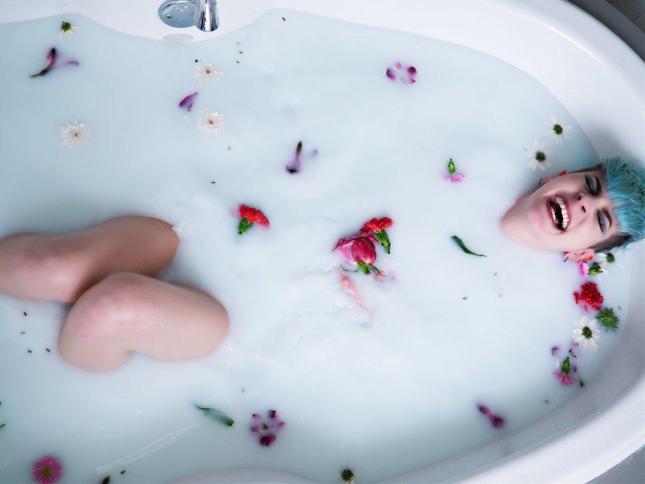 Ash cracking up during a milk bath shoot