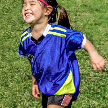 happy smiling girl after scoring goal