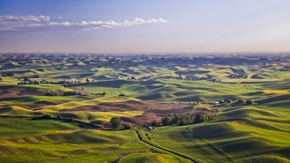 The rolling hills of the Palouse in eastern Washington are full of farms. This is taken from Steptoe Butte giving a panoramic view of the beautiful countryside...