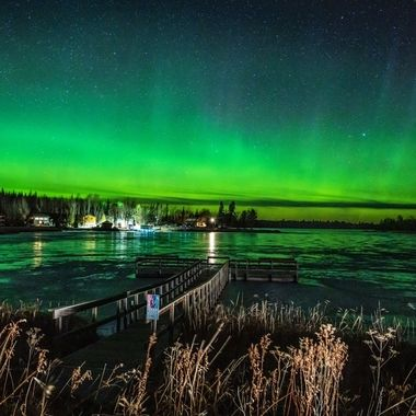 The Northern Lights were amazing tonight as car lights illuminated the dock and shoreline! The melted snow on the ice made a nice reflective surface!