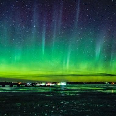 Beautiful display of Northern Lights taken over Jackfish Bay on Rainy Lake from the lake ice next to the parking lot