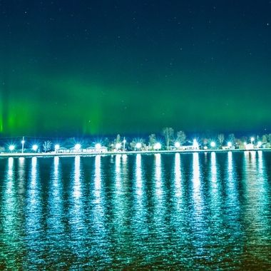 Even with all the light in the foreground the northern lights shone through! Taken from Voyageurs National Park Headquarters shoreline of Fort Francis Ontario, Canada