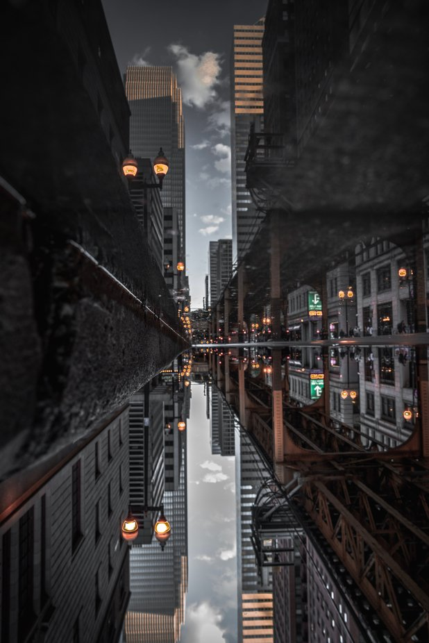 The week I was in Chicago there were a couple of rainy days. As I was walking through the city this puddle just caught my eye with the view it had in front of it. The reflection was perfect since the water was still.  by williamdunn_9877 - Urban Captures Photo Contest