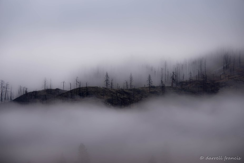 Fog breaking up over the mountains of Southern British Columbia