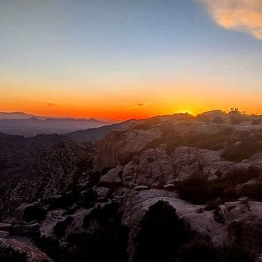 Sunset on Mt Lemmon Tucson Arizona 3/27/21  Those are people standing way out on the rocks. This is a photo is best viewed enlarged. Amazing capture!  Photo was shot by my field photographer Lenore S.