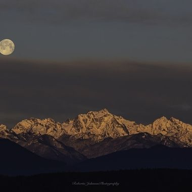 Worm Moon setting with Mt. Constance, The Olympic Mountains, Hood Canal, Washington, USA
