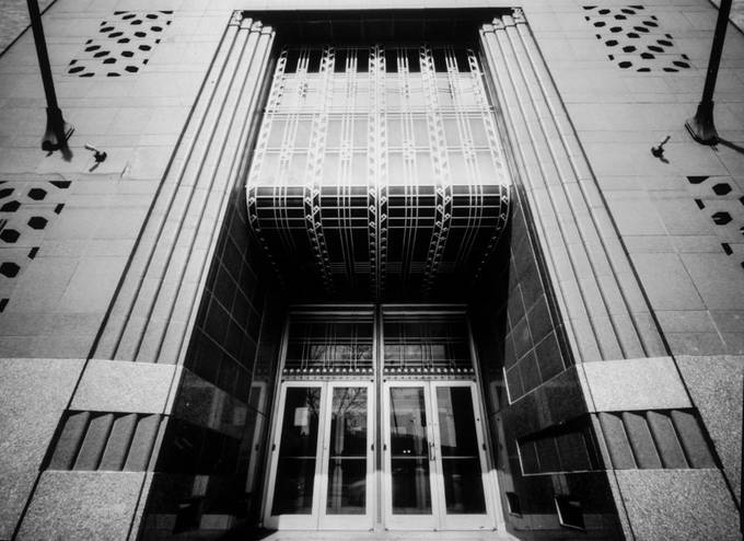 Just one of the many art deco buildings in downtown Tulsa, Oklahoma. This image made with a Ranica Viasna 8x10 pinhole camera on Ilford RC Grade IV photopaper. Shot at ISO 6, dev'd in Kodak Dektol.