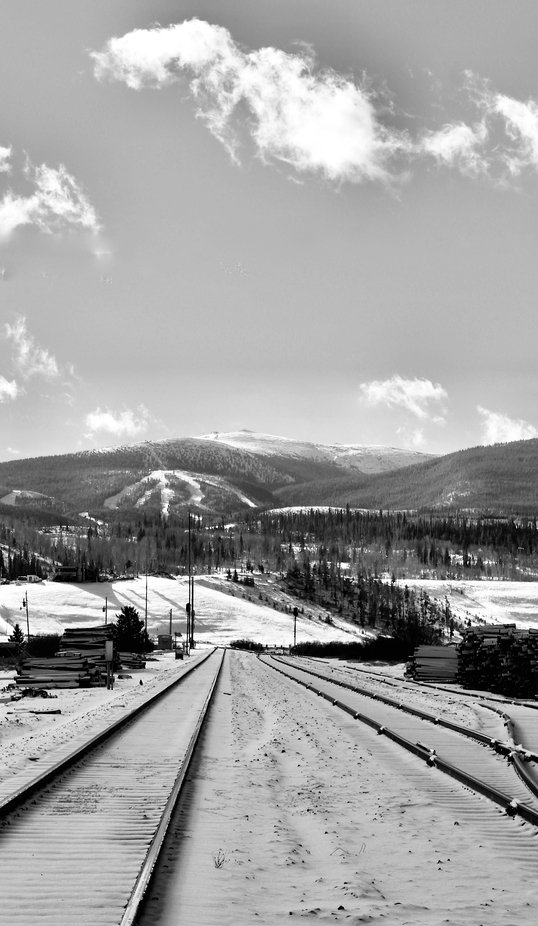 Train tracks in the Rocky Mountains near Fraser, Colorado.