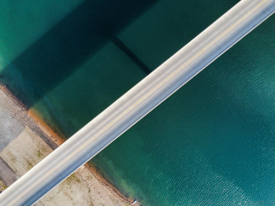 I took this image with my drone of a bridge over water with the shadow.
