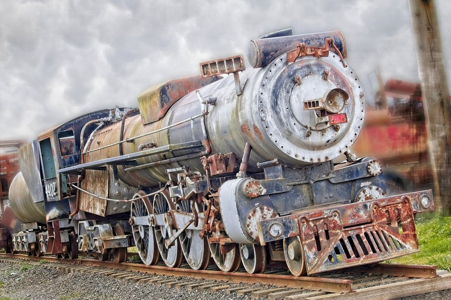 An old train in Oregon. Shows the old colors and rust that create the vintage look and feel.