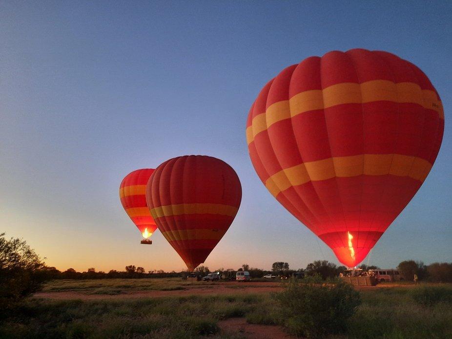 three Hot air balloons at sunrise