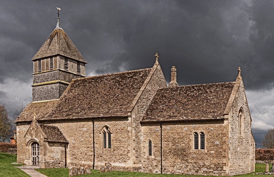 Storm clouds over St Mary Magdalene church in Winterbourne Monkton, wiltshire