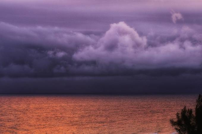 Storm coming in off the Atlantic before sunset creating such colors of purple, grey and golden shores.