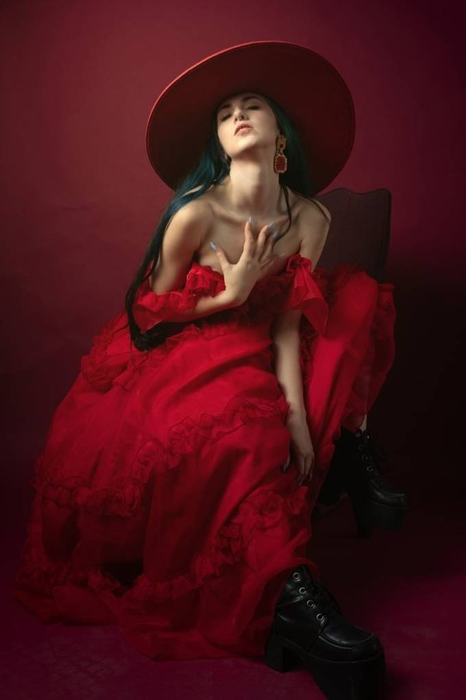 Art model Aubry models this large red dress by LibraryOKC and a red hat in this fashion editorial for Shuba Magazine.
