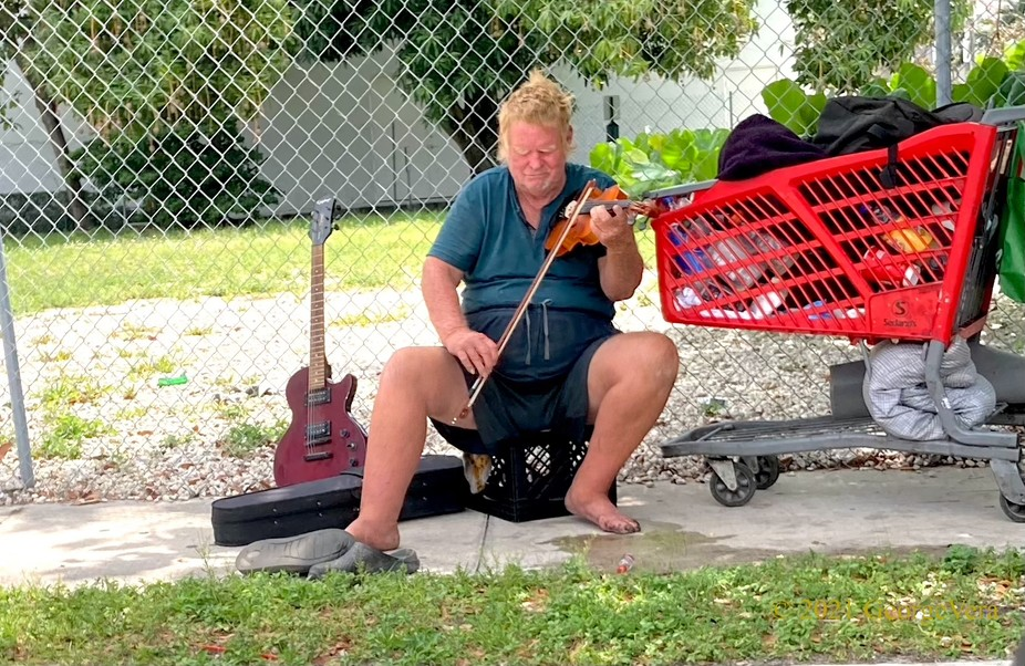 Homeless and violinist...