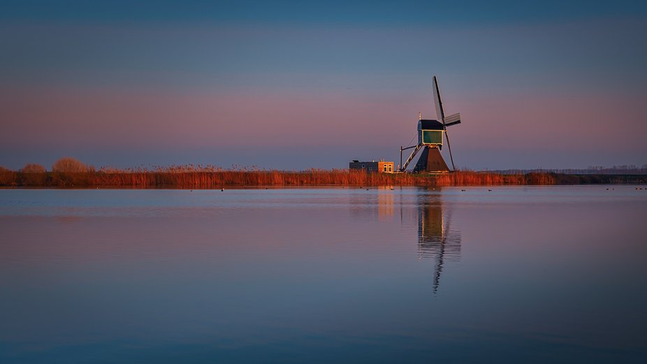 A Dutch windmill in beautiful sky