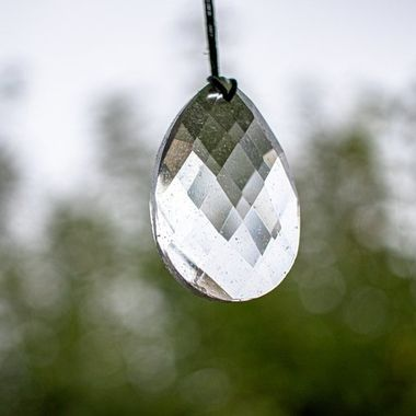 Cool bokeh behind a crystal swinging in the wind