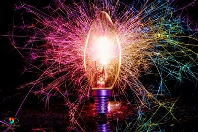 Colourful sparking lightbulb