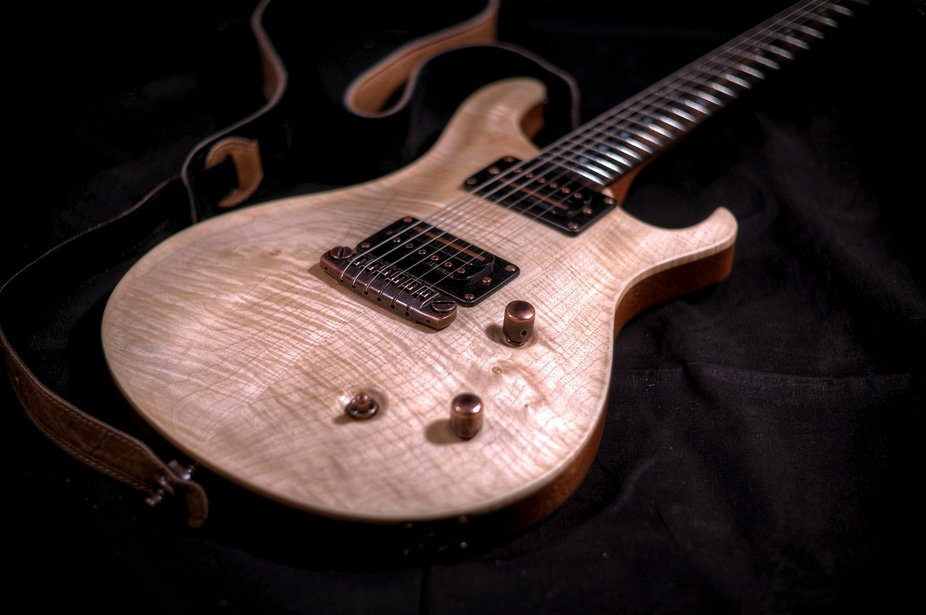 The guitar I built on (and for some time after) my 50th birthday from a kit. Mahogany and Maple b...