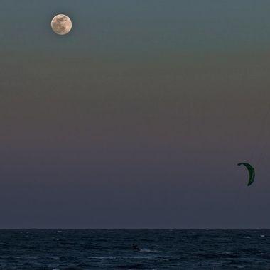 Kitesurfing under the full moon