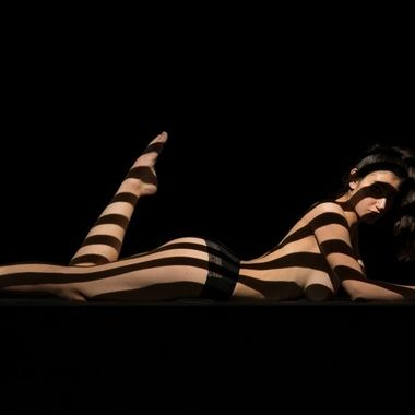Projection of lines with a metal gobo and a lightblaster on a beautiful woman's body