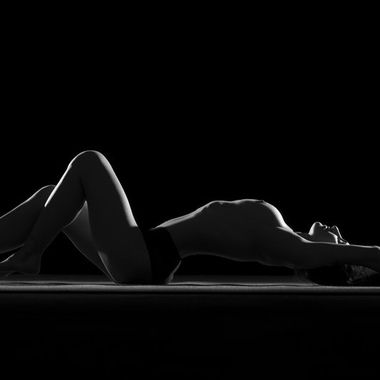 Silhouette of a woman's body.