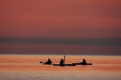 Three kayakers